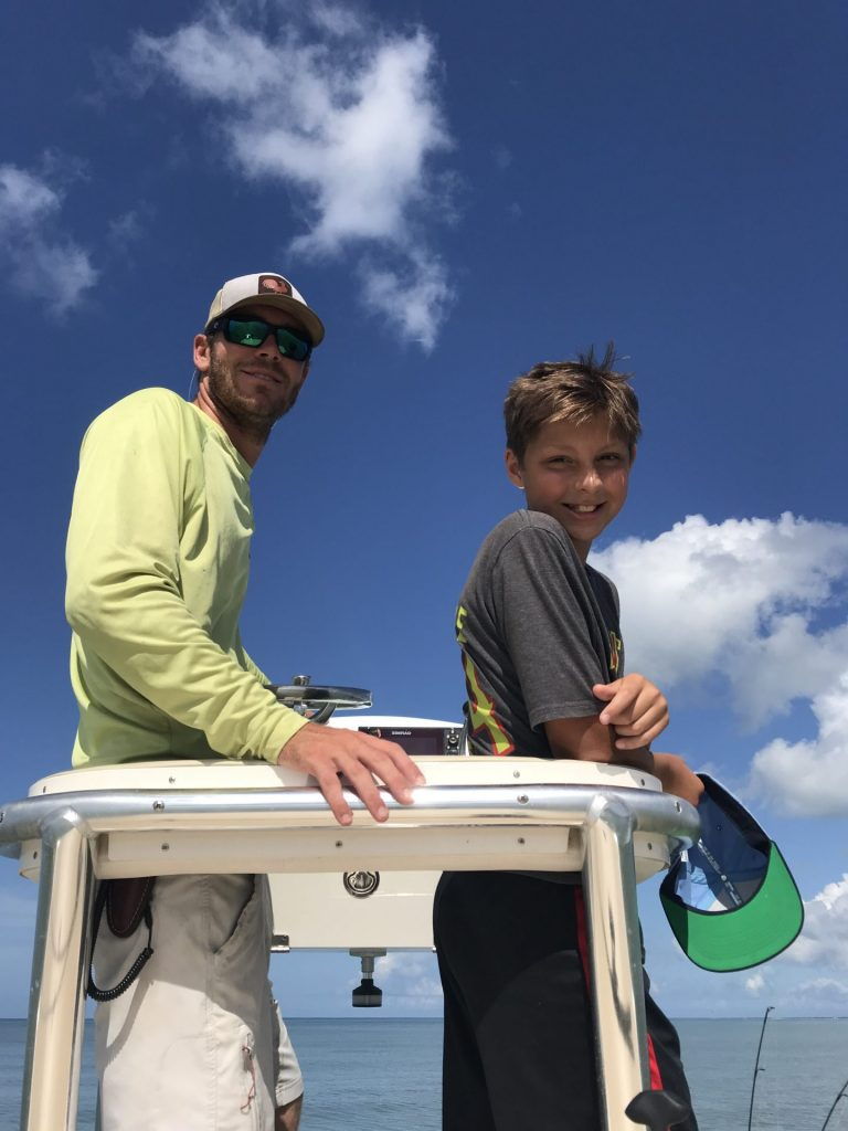 Capt. Zach and young angle on his boat