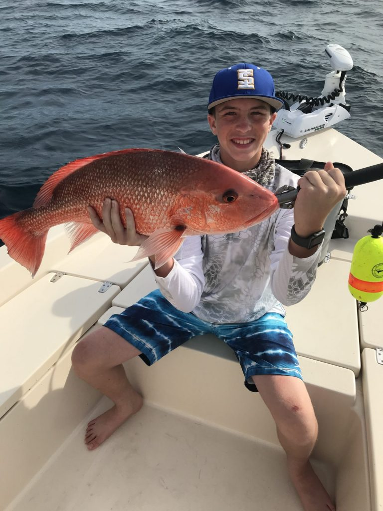 Young Angler Holding a Red Snapper